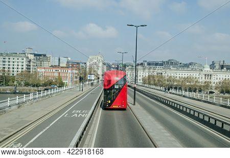 London, Uk - April 21, 2021: A Red Double Decker Bus Travelling Towards Aldwych Across Waterloo Brid