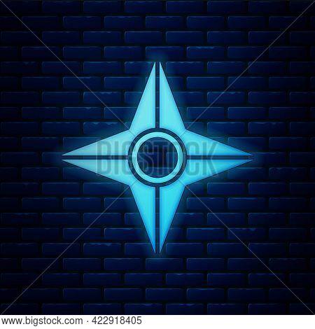 Glowing Neon Japanese Ninja Shuriken Icon Isolated On Brick Wall Background. Vector