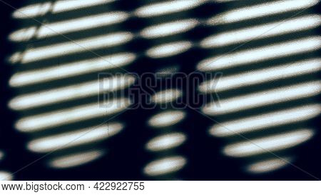 Shadow From The Blinds Through The Handles Of The Scissors. Round Handles From Scissors Through Whic
