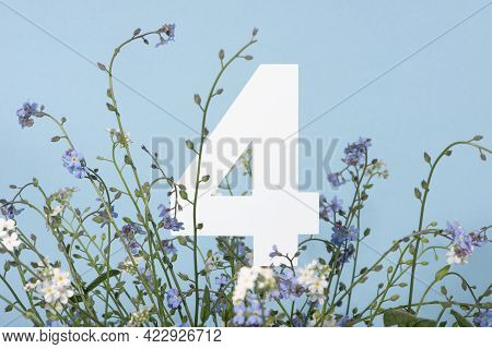 Number Four Among Blue Flowers On Blue Background. Birthday, Anniversary, Jubilee Concept. For Invit