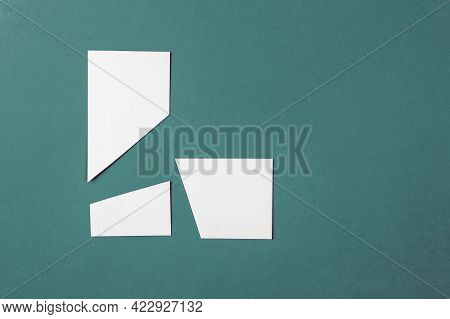 Random White Geometric Shapes. Trapezes On The Green. Top View. Copy Space.