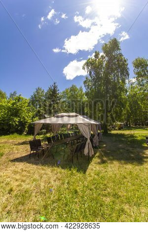 Provision Of Catering Services In Nature. Tent With Tables And Chairs On The Grass. Exit Lunch Compa