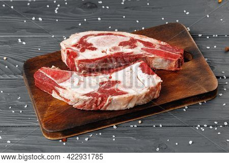 Uncooked Raw Beef Brisket On Wooden Board
