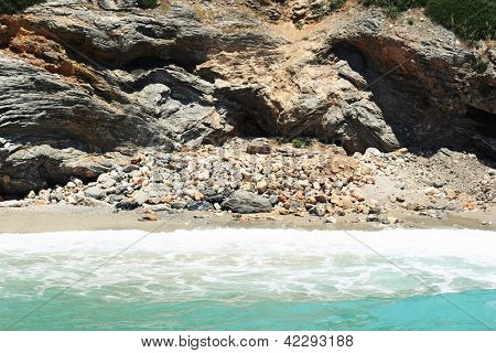 Sea landscape with high unapproachable rock