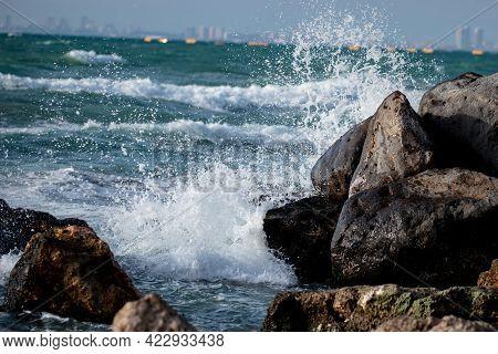 Waves Crash On Stones On The Seashore