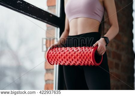 Girl Holding Fascia In Her Hands Preparing For Workouts In The Gym Standing Against The Background O