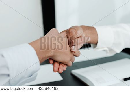 Photo Of Female Hands. Businessmen Conclude An Agreement Shaking Hands Over The Table