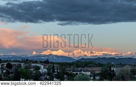 Sunset Light On Mountain Range Eiger Moench And Jungfrau Above Bern Suburbs