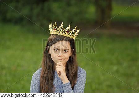 Cute Girl Golden Crown Outdoors Green Nature Background, Grumpy Princess Concept