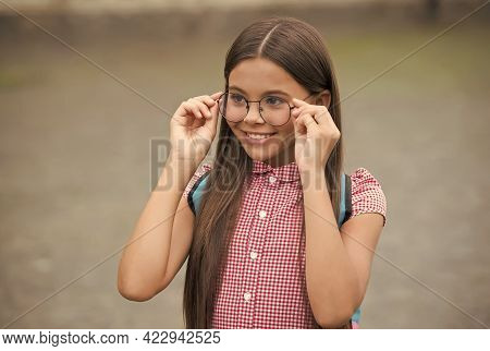 Happy Little Girl With Long Hair Fix Glasses On Nose With Cute Look Summer Outdoors, Eyewear