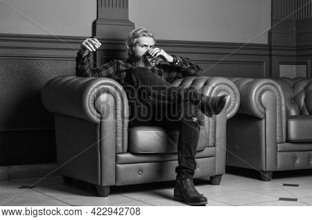Need Good Relax. Male Club. Glass Whisky In Male Hand. Brutal Bearded Hipster Smoking Cigarette Drin