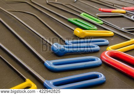 Paintless Dent Repair Kit Tools Set On The Work Table. Tools For Repair Dents On Car Body. Professio