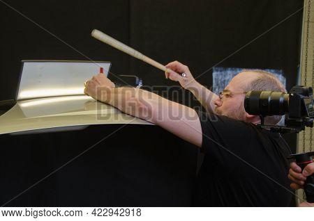 Professional Paintless Dent Repair Technician Is Repairing Dents On Car Body. Operator Filming Onlin