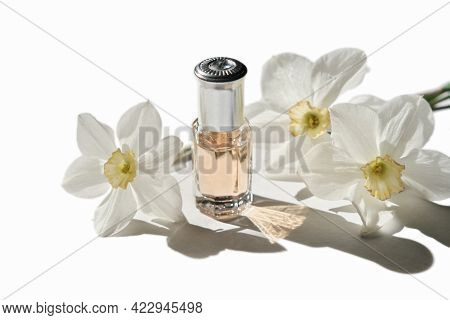 Perfume Oil Flower Scented Isolated On White Background. Isolated Bottle Of Fragranced Oil And White