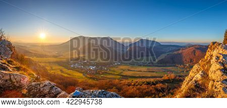 Mountainous Landscape In Autumn At Sunset. Panoramic View From The Top Of The Bosmany Rocky Hill Abo