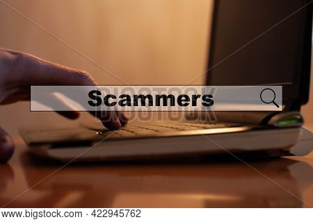 Scammers. Concept Of Scammers Working On Black Computer