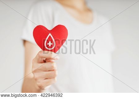 Woman Hands Holding Red Heart With Blood Donor Sign. Healthcare, Medicine And Blood Donation Concept