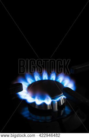 A Close Up Of The Blue Flame Of Natural Gas On A Cooker Ring Or Hob
