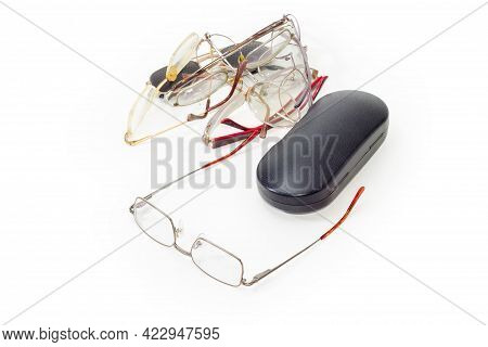 New Modern Classic Eyeglasses For Men In Metal Rim And Closed Hard Spectacle-case Against A Pile Of