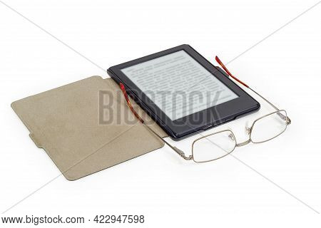 Modern Classic Eyeglasses For Men In Metal Rim With Open Temples Against The Open Ebook With Blurred
