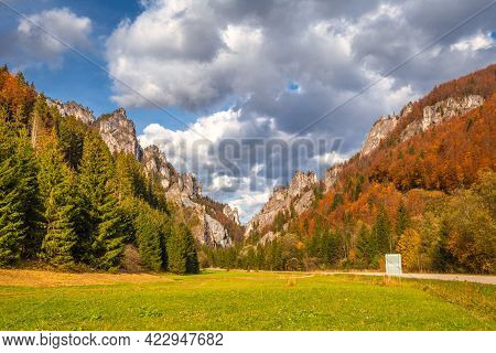 Road Through A Rocky Gorge In A Mountain Valley At Autumn. The Vratna Valley In Mala Fatra National