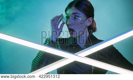 Shocked Woman. Cyberpunk Portrait. Innovative Technology. Impressed Overwhelmed Girl In Protective G