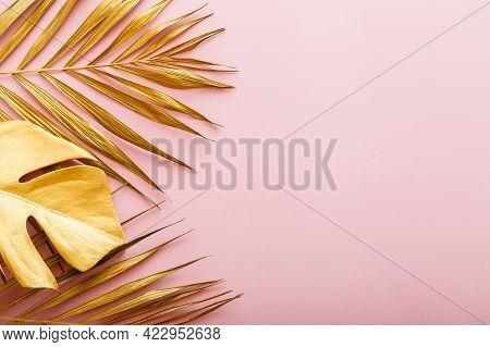 Golden Palm Leaf, Tropical Leave Frame On Pink Background With Copyspace. Summer Backgroun Gold Flor