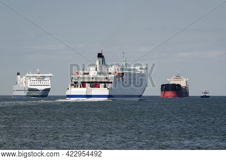 Maritime Transport  - Passenger Ferrys And Bulk Carrier On Waterway To The Port