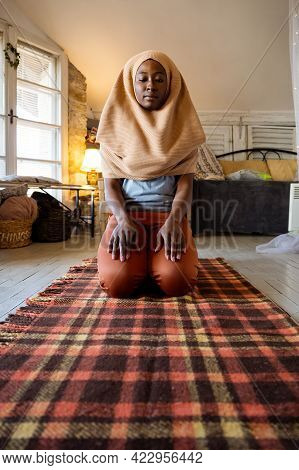 Young Muslim Woman Praying. Islam, Muslim Religion Concept