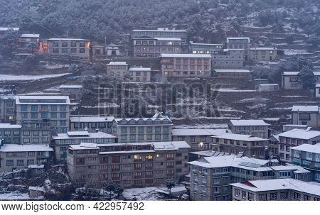 Lights On In The Hotels Of Namche Bazaar With A Gentle Snow Falling.