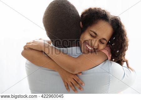 Emotional Black Girl Hugging Her Daddy, Closeup