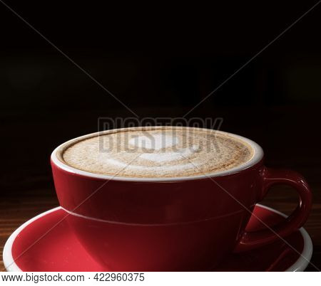 Coffee Cup On Dark Background With Copyspace. Latte Art O9N Top Froth