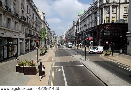 London, Uk - April 21, 2021: View Looking Along The Famous Posh Shopping Area Regent Street Shortly