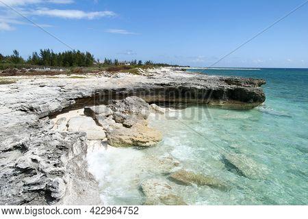 The Transparent Waters Washing Eroded Rocky Coastline On Grand Bahama Island.
