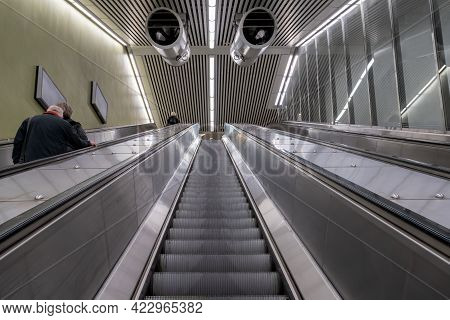 Stockholm, Sweden - May 25, 2021: Perspective View Of People Going Up An Escalator At A Public Train