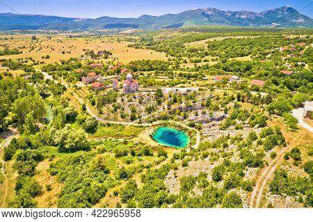 Dalmatia Hinterland. Cetina River Source And Orthodox Church Aerial View, Dalmatian Zagora Region Of