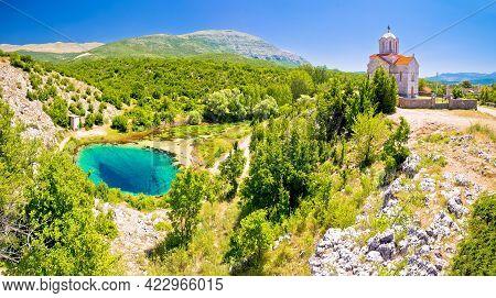 Cetina River Source Water Hole And Orthodox Church Panoramic View, Dalmatian Zagora Region Of Croati