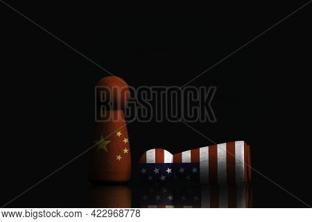 China Figure Standing And Usa Figure Falling On Dark Background , China And United States Of America