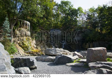 Stone Mountain Waterfall And Lake. A Picturesque Cascade Waterfall Among Large Stones In The Landsca