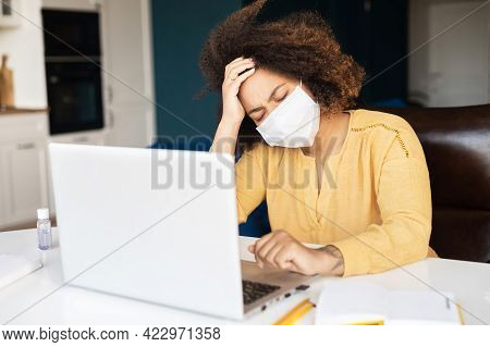 Suffering From Headache African-american Woman In Protective Medical Mask, Tired And Weary Female Em