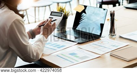 Businesswoman Working On Desk Office With Using A Calculator To Calculate The Numbers, Finance Accou