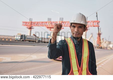 Asian Engineers Work On Construction Sites,  Asian Engineers Show Their Commitment To Road Construct