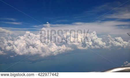 Beautiful White Clouds And Rain Clouds In Blue Sky View From A Plane, Look Over Gulf Of Thailand And