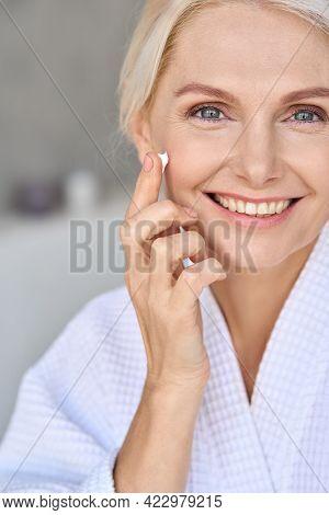 Vertical Portrait Of Beautiful Mid Age Older Adult 50 Years Old Blonde Woman Wears Bathrobe In Bathr
