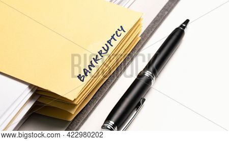 Close-up View Of Ring Binder With Word Bankruptcy Written On Binding Divider
