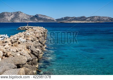 Stone Breakwater With A Lighthouse Aerial Drone View.koufonisia Cyclades Islands, Greece