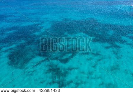 Greece, Cyclades. Aerial Drone View Of Turquoise Color Sea Water