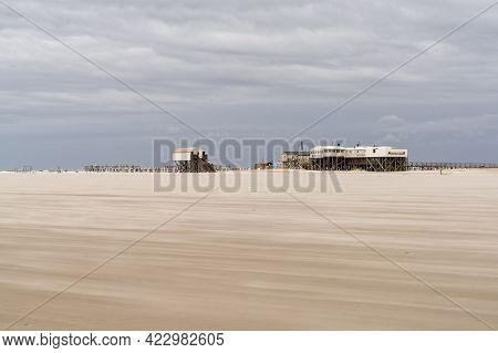 Sankt Peter-ording, Germany - 26 May, 2021: View Of Beachfront Buildings On Stilts On The Wadden Sea