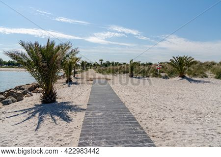 A Wooden Boardwalk And Sandy Path Leading To The Palm Beach In Frederikshavn