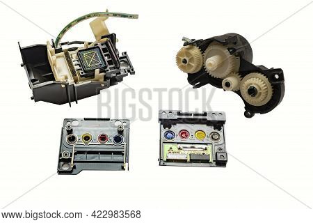 Disassembled Printhead, Gearbox, Pump From A Color Inkjet Printer Lie Separately On A Clean, Empty W